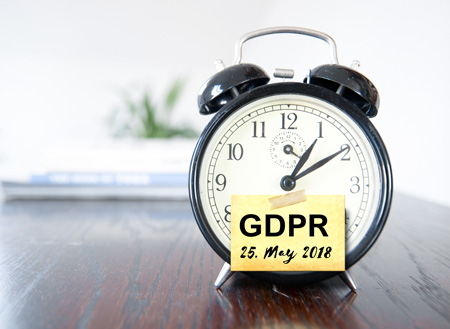 Are you preparing for GDPR compliance? Alarm clock with GDPR compliance deadline of May 25, 2018, on a post-it note.