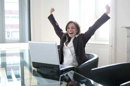 Business woman celebrating improved email response rates
