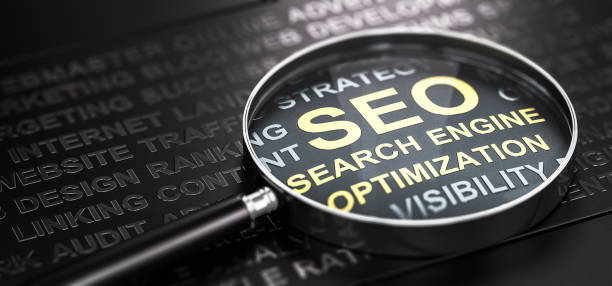 Magnifying glass with SEO under it.