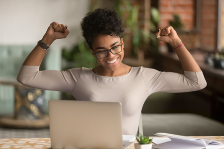 African American woman rejoicing over email marketing win.